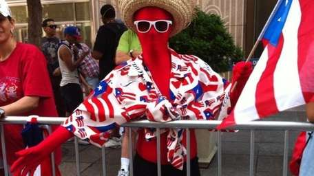 A spectator dresses up in costume for the