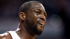 Miami Heat guard Dwyane Wade reacts in the