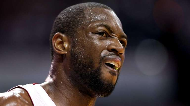 Miami Heat guard Dwyane Wade reacts in the