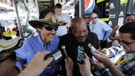 Richard Petty, left, a former NASCAR driver and