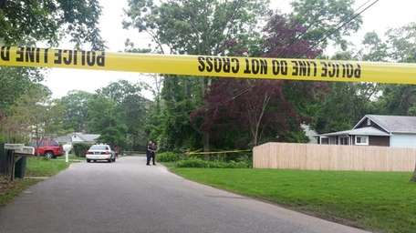 Suffolk County police investigate the scene near a