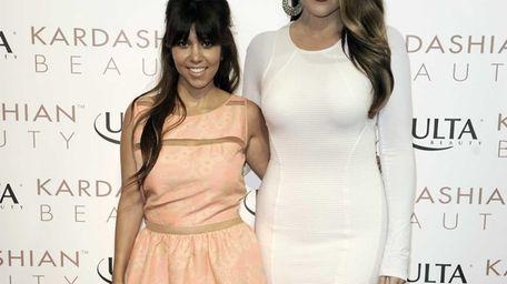 Kourtney Kardashian, left, and Khloe Kardashian attend the