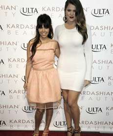 Kourtney Kardashian, left, and Khloe Kardashian attend the