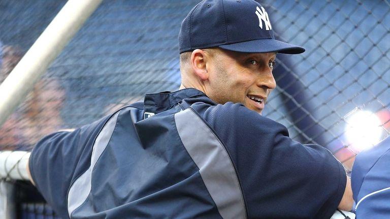 Derek Jeter of the Yankees looks on prior