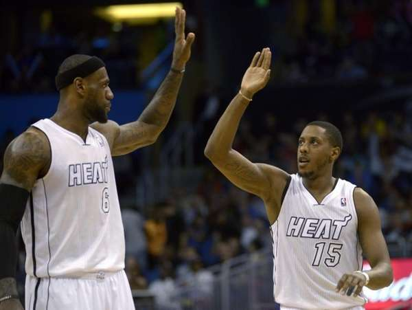 Miami Heat guard Mario Chalmers, right, is congratulated