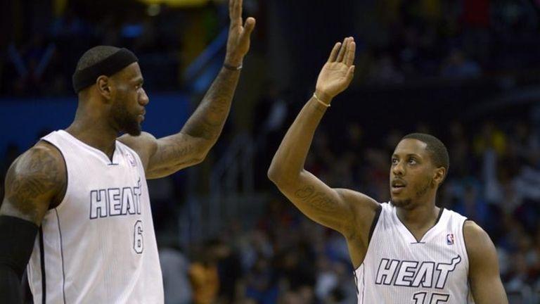 Miami Heat guard Mario Chalmers, right, is congratulated