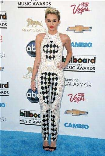 Miley Cyrus arrives at the Billboard Music Awards