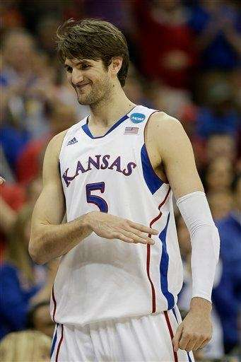 Kansas center Jeff Withey smiles after coming out