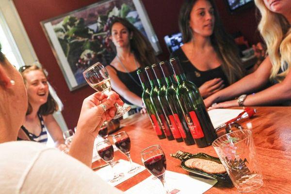 Guests visit the tasting room at Harmony Vineyards