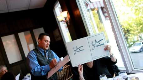 Patrons dine at The Jolly Fisherman and Steak