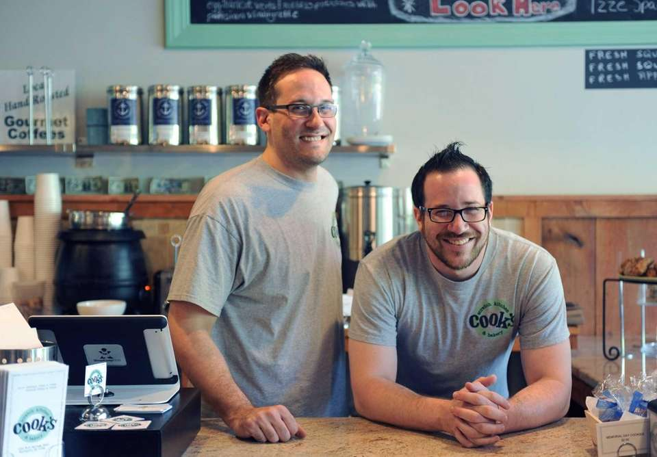 Owners Dave and Josh Cook behind the counter