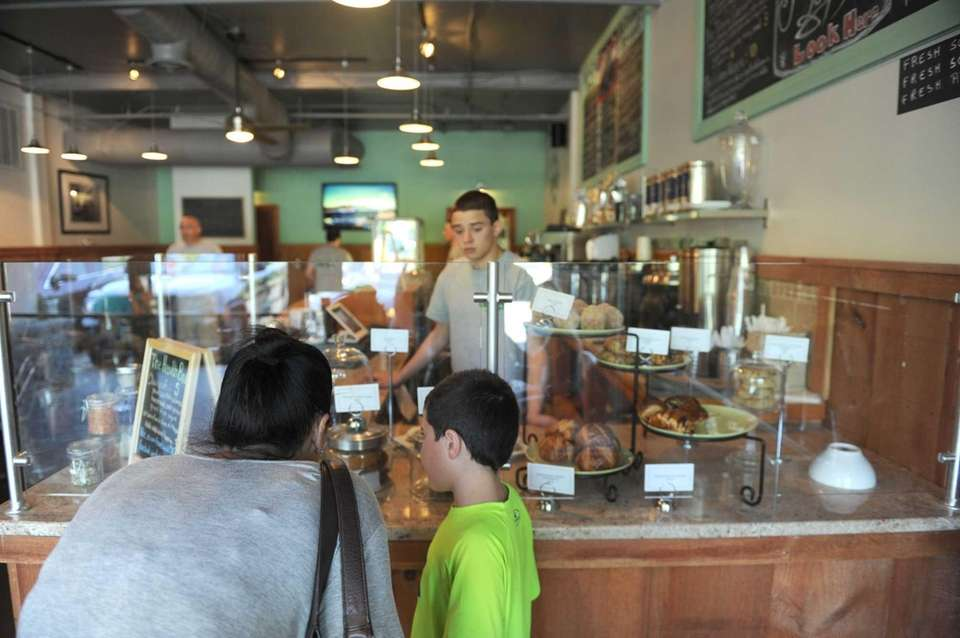 Customers look at irresistible pastries at Cook's Scratch