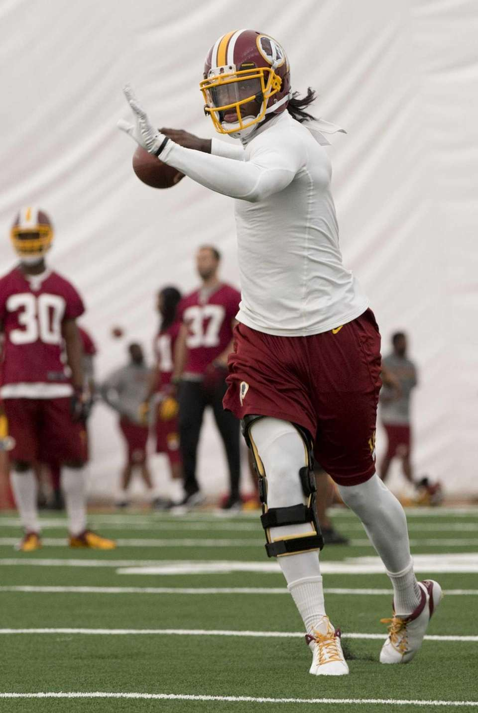 Washington Redskins quarterback Robert Griffin III throws during