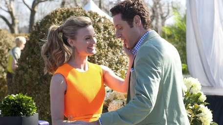 Brooke D'Orsay as Paige Collins and Paulo Costanzo