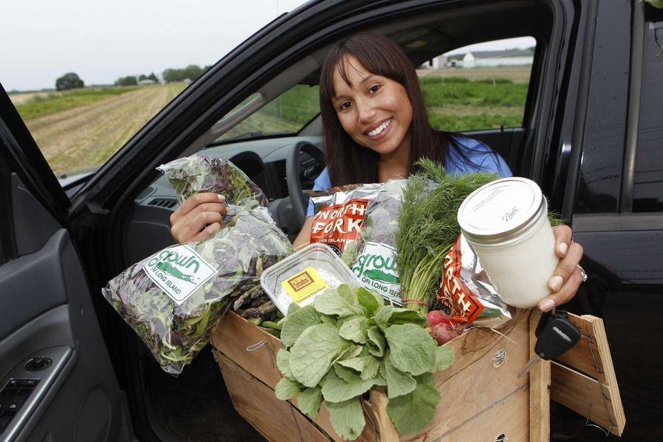 Kassata Bollman, owner of Farm2Kitchen Long Island, sits