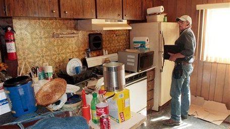 FEMA inspector Bruce Grass performs an assessment of