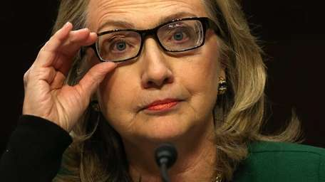Then-Secretary of State Hillary Clinton testifies before the