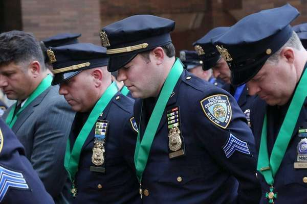 NYPD Sgt. Kevin Brennan, second from right, was