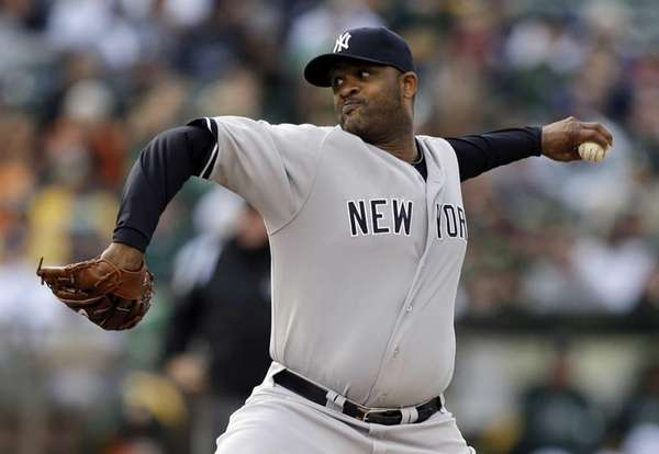 Yankees' CC Sabathia works against the Oakland Athletics