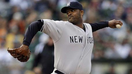 Yankees' CC Sabathia works against the Oakland Athletics