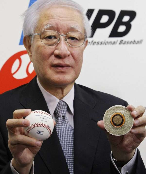 Nippon Professional Baseball commissioner Ryozo Kato announces the