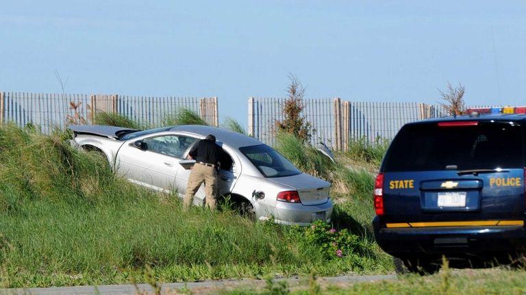 New York state police investigators probe single car