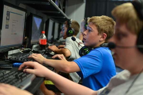 Matt Kearney, 14, of Centerport, plays computer games