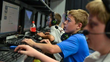 Matt Kearney, 14, of Centerport, plays computer games