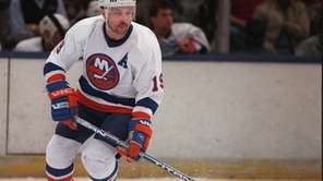 Bryan Trottier moves the puck down ice. (Feb.