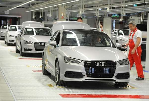 An employee works on an Audi A3 car