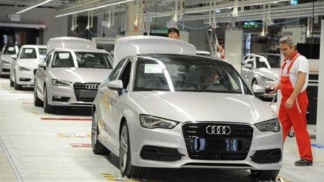 An employee works on an Audi A3 car