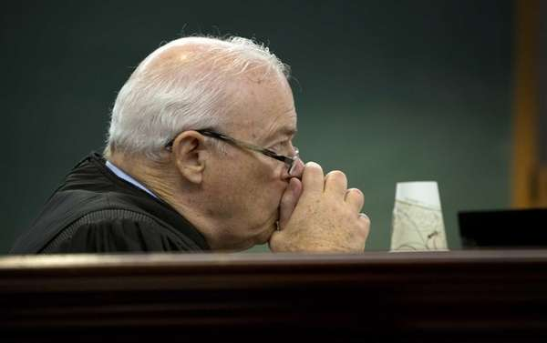 Circuit Judge Ronald Dresnick listens to arguments from
