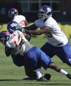New York Giants guard Bryant Browning tries to