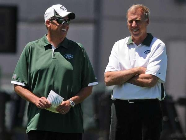 Jets head coach Rex Ryan, left, speaks with