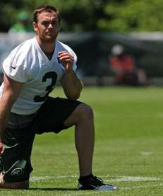 Jets punter Robert Malone takes a knee during