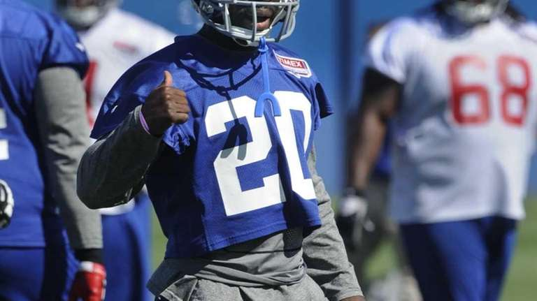 Giants cornerback Prince Amukamara talks with a coach