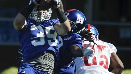 Tyler Sash intercepts a pass intended for wide
