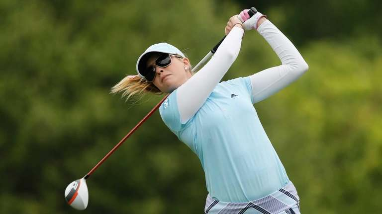 Paula Creamer hits her tee shot on the
