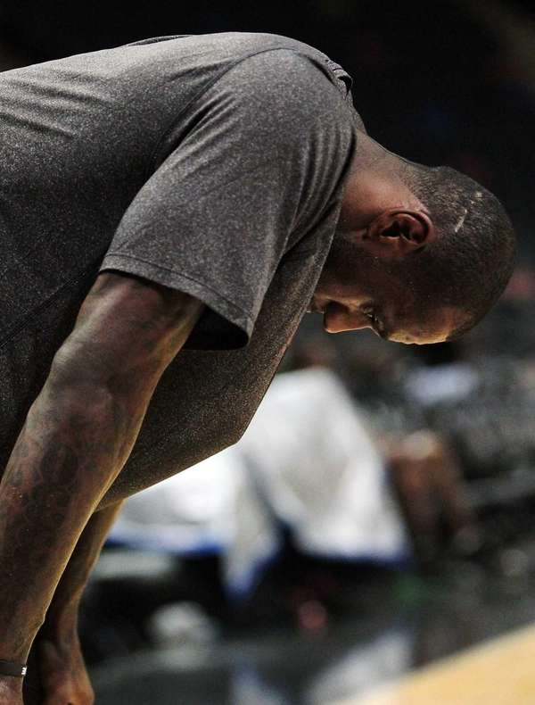 Miami Heat forward LeBron James pauses during the