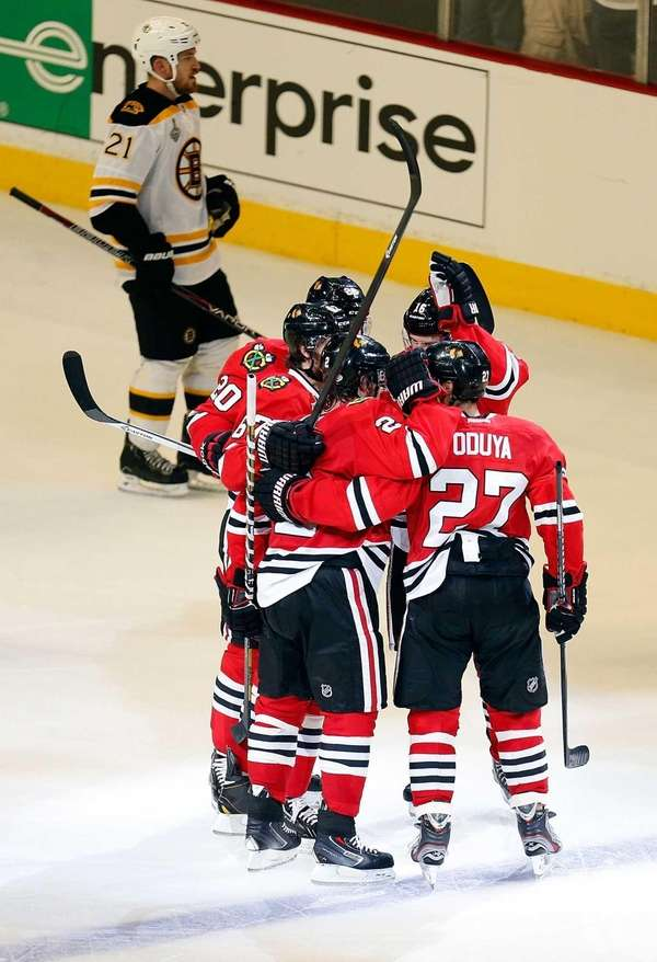 Johnny Oduya of the Chicago Blackhawks celebrates with