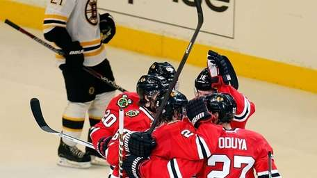 Johnny Oduya of the Chicago Blackhawks celebrates with