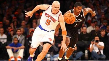 Jason Kidd plays against Joe Johnson #7 of