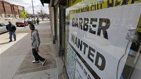 A help wanted sign is displayed at a