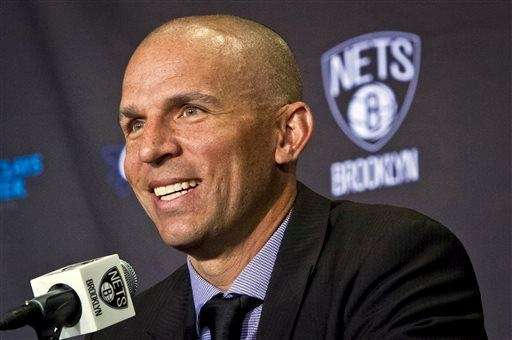 Jason Kidd smiles as he is introduced during