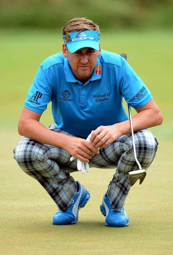 Ian Poulter lines up a putt on the