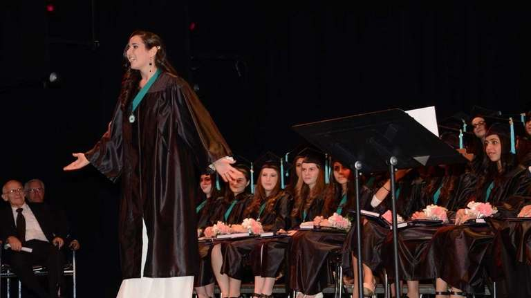 Graduate Annelle Amsellem, 17, of Great Neck, delivers