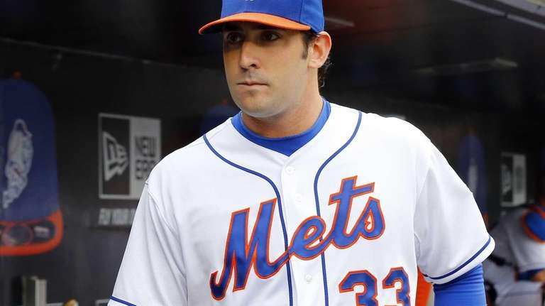 Matt Harvey leaves the dugout after the seventh