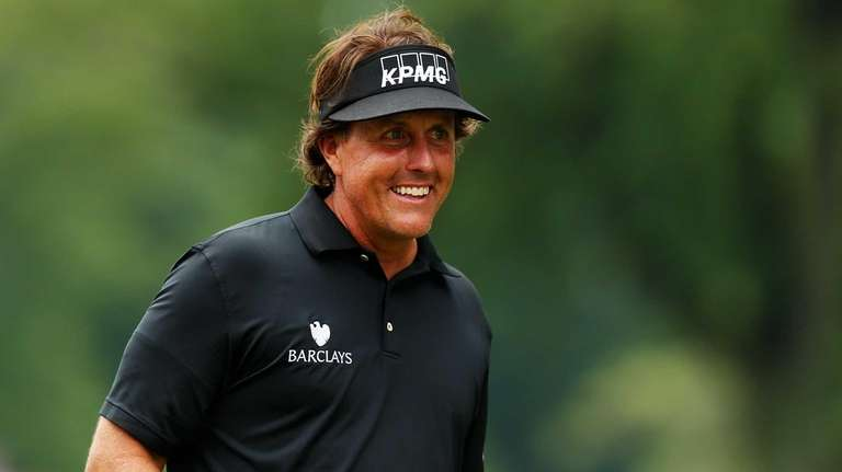Phil Mickelson hits his tee shot on the