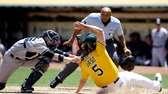 Oakland Athletics catcher John Jaso slides safely under