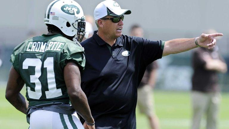 Jets coach Rex Ryan talks with Antonio Cromartie